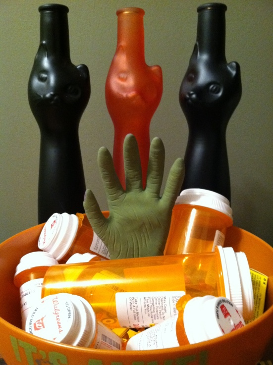 Halloween candy bowl full of prescription containers